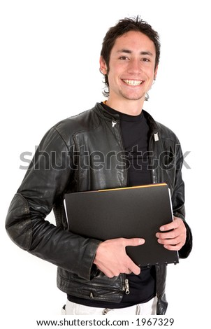 casual guy smiling with his notebook in the way to university