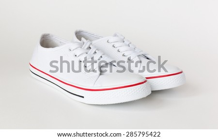 casual gym-shoes isolated on white - stock photo