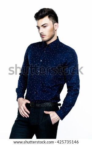 Casual handsome attractive portrait  of mature businessman wearing dark blue shirt on white background - stock photo
