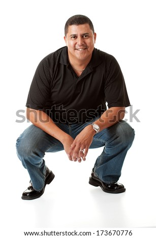 Casual: Handsome Hispanic Male Crouching Down - stock photo