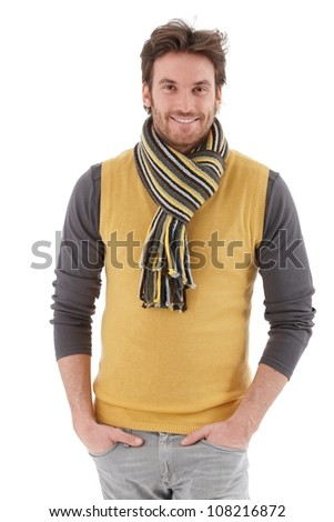 Casual handsome man smiling at camera, hands in pocket. - stock photo