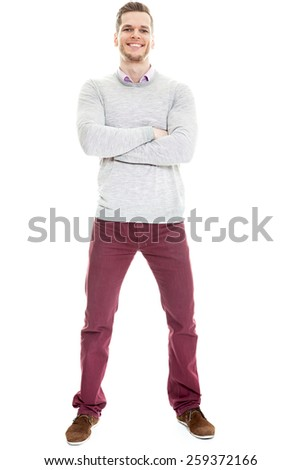 Casual handsome young man full length isolated on white background - stock photo
