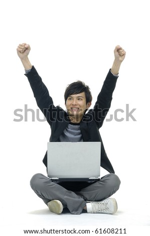 Casual happy man with his arms up, using laptop isolated