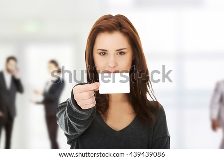 Casual happy woman with business card - stock photo