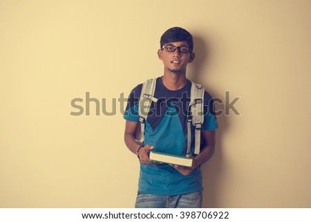 casual Indian male student with book - stock photo