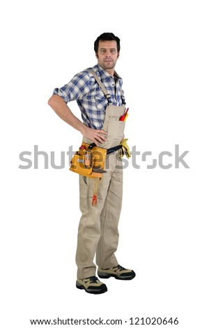 Casual male carpenter  stood with hands on hips - stock photo
