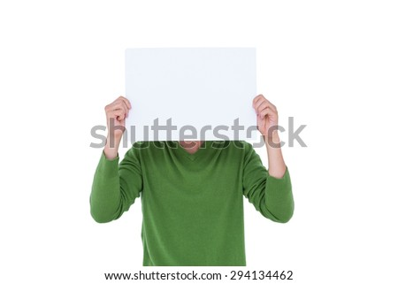 Casual man hiding his head with blank paper on white background