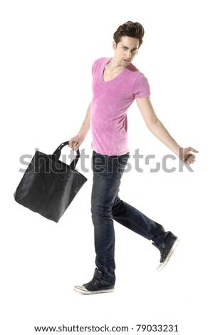 casual man holding handbag walking towards the camera isolated - stock photo