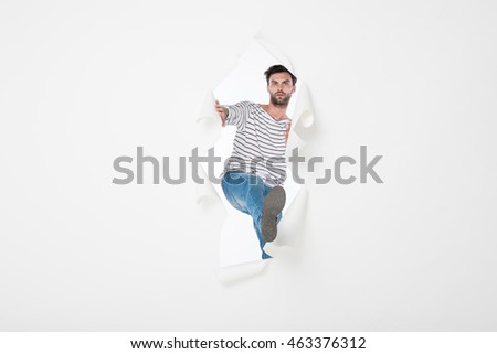 Person Breaking Through Wall