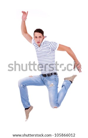 casual man jumping of joy � isolated over a white background - stock photo