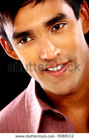 casual man portrait smiling - isolated over a black background