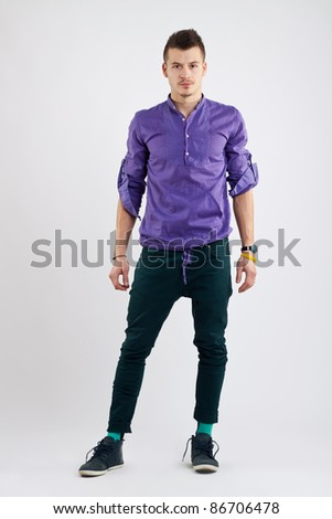 casual man standing isolated over a white background - stock photo