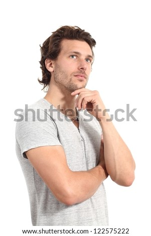 Casual man thinking with a hand in his chin and a white isolated background