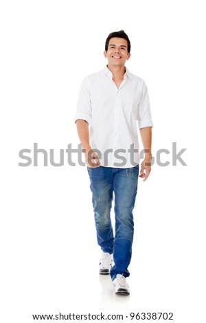 Casual man walking - isolated over a white background - stock photo