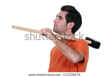 Casual man with a sledgehammer. - stock photo