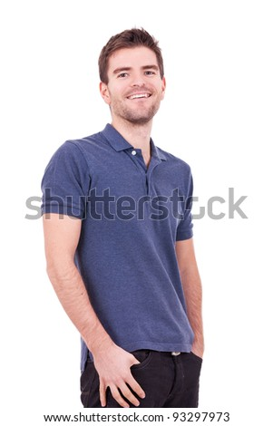casual man with his hands in pockets on white background - stock photo