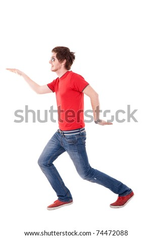casual man with red t-shirt making a dance move, isolated - stock photo