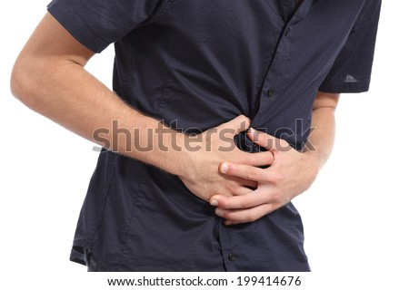 Casual man with stomach ache isolated on a white background - stock photo