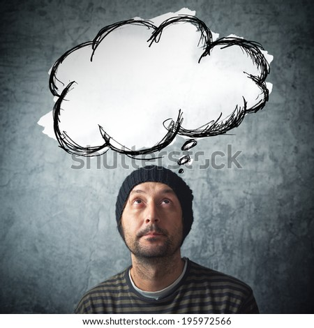 Casual man with thinking balloon cloud with copy space for your text or graphics - stock photo