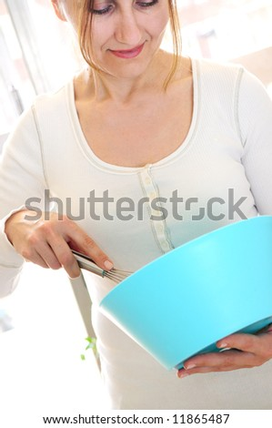 Casual mature woman enjoying cooking at home - stock photo