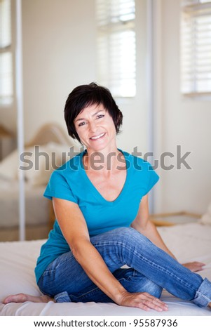 casual middle aged woman relaxing at home - stock photo