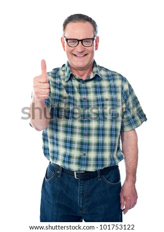 Casual old man showing thumbs-up sign to camera isolated over white background - stock photo