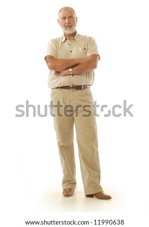 Casual older male standing on white background - stock photo