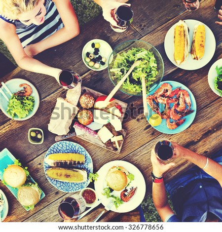 Casual People Eating Together Outdoors Concept - stock photo