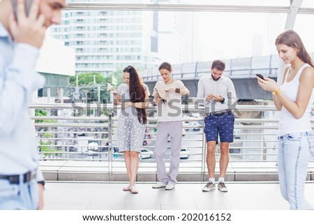 Casual people in the city crowd - stock photo