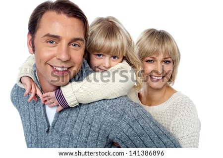 Casual portrait of a cheerful family of three