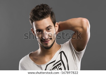 Casual portrait of a young man laughing isolated over a white background - stock photo