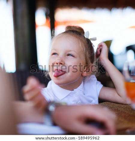 Casual portrait of adorable playful little girl