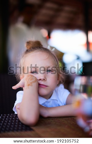Casual portrait of adorable sad or bored little girl - stock photo