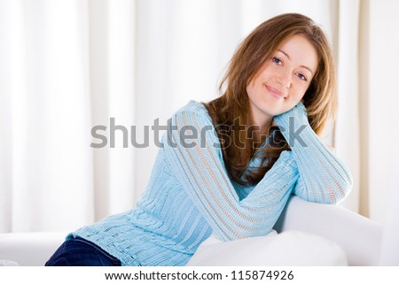 Casual portrait of an attractive young woman relaxing at home