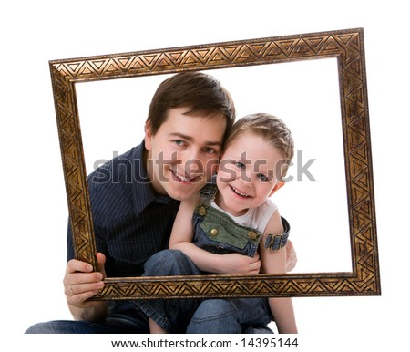 Casual portrait of father and son having fun together playing with frame. Isolated on white