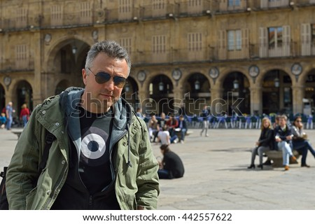 Casual portrait of handsome man with sunglasses, spring outdoor. - stock photo