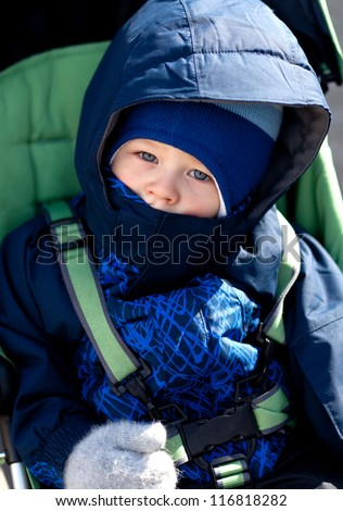 casual portrait of toddler boy in warm winter clothes - stock photo