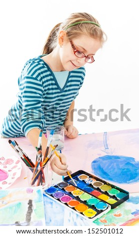 Casual schoolgirl painting with watercolor on white background