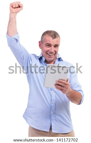casual senior man holding his tablet and cheering while smiling for the camera. isolated on white background - stock photo