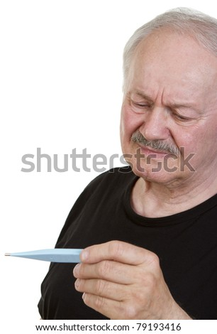 Casual senior man suffering from a cold and checking his temperature on a digital thermometer. - stock photo