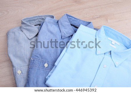 Casual shirts on wooden background