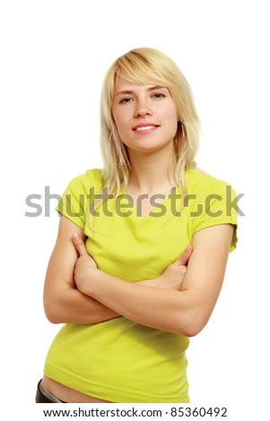 Casual smiling girl with folded arms isolated - stock photo