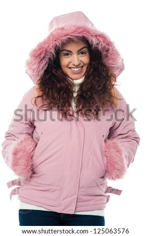 Casual smiling portrait of a charming woman in winter clothing. - stock photo