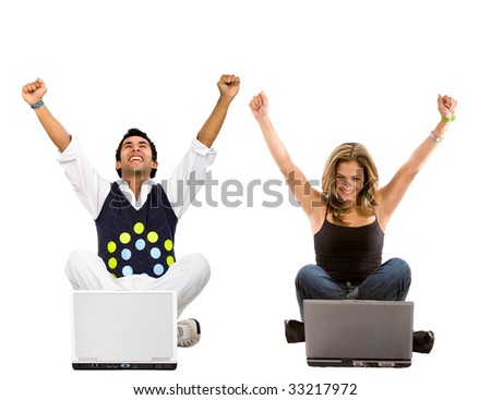 casual successful couple on laptop computers isolated - stock photo