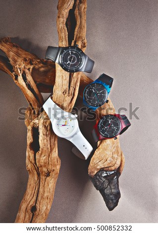 casual watches on a concept on a tree trunk in pan