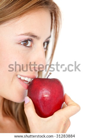casual woman eating a red apple isolated