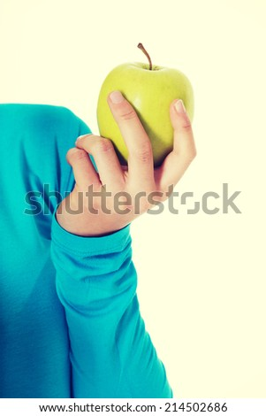 Casual woman holding an apple. Isolated on white. - stock photo