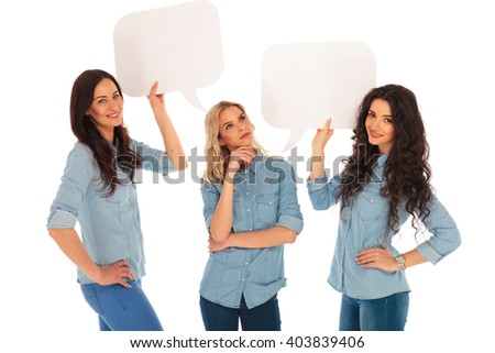 casual woman is thinking while her friends are holding speech bubbles on white background - stock photo