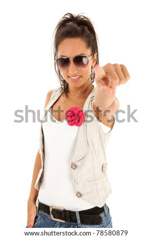 casual woman pointing at you - Portrait of an attractive young woman pointing her finger. Isolated on white background - stock photo