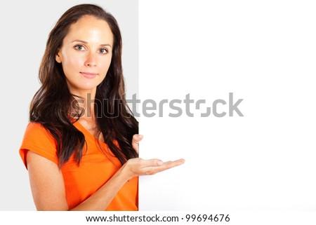 casual woman presenting white board - stock photo